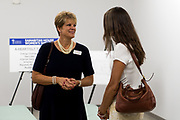DENVER, CO - AUGUST 24: Jean Finegan (L) speaks with another attendee of the grand opening at the Samaritan House Women's Shelter on August 24, 2017, in Denver, Colorado. (Photo by Anya Semenoff/for Catholic Charities)