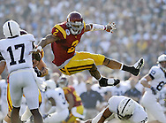 USC's Taylor Mays gets some air while putting pressure on Penn State quarterback Daryll Clark during the Trojans' 38-24 victory over Penn State in the 2009 Rose Bowl Thursday...///ADDITIONAL INFO:  rosebowl.0102.kjs16.jpg  ---  Photo by Kevin Sullivan, The Orange County Register --  1/1/09..Photographed Thursday January 1, 2008.  .