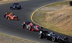 Richard Antinucci (98) leads Justin Wilson (18) on a downhill turn at Sonoma.  The 2009 Sonoma Grand Prix IndyCar race was held at Infineon Raceway in Sonoma, California on August 23, 2009.