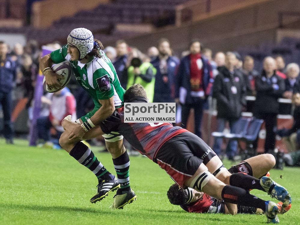 London Irish #6 Blair Cowan offloads the ball whilst being tackled by Edinburgh #6 Mike Coman . Edinburgh Rugby v London Irish, 18th December 2015