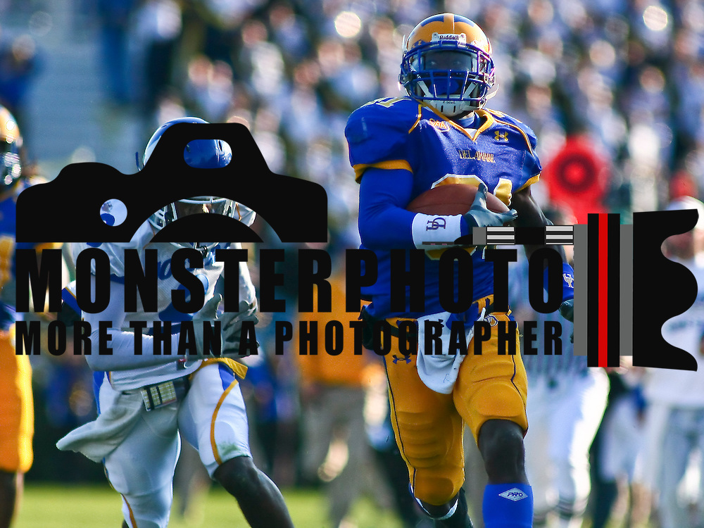 Newark DE, 11/07/2009: Running Back Jerry Butler scored two touchdowns, including the game-winner early in the fourth quarter, and linebacker Benard Makumbi came up with a big stop on a fourth down play inside Delaware territory in the final minute as the No. 23 ranked Blue Hens got by Hofstra for an important 28-24 Colonial Athletic Association football win Saturday afternoon at sunny Delaware Stadium....Buy/License/Royality Free @ monsterphotoiso.com.