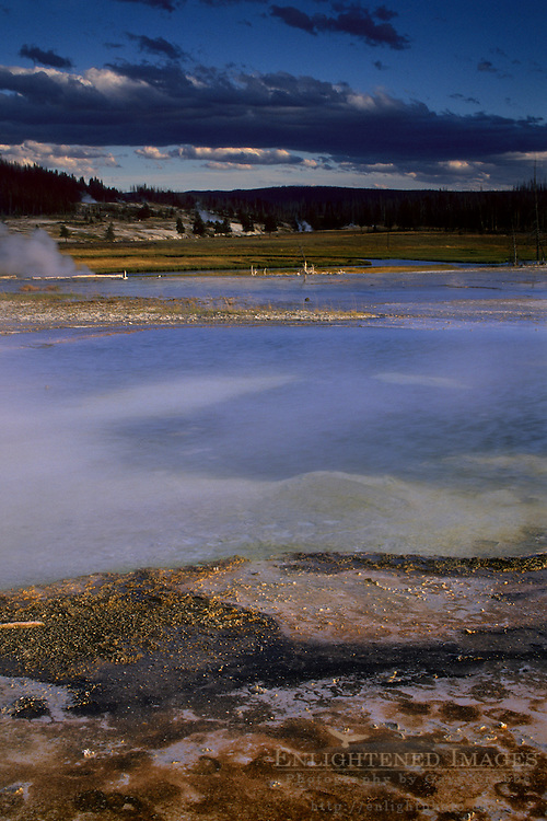 Mineral deposits at edge of thermal hot spring at sunset, Biscuit Basin, Yellowstone National Park, WYOMING