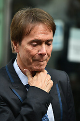 © Licensed to London News Pictures. 18/07/2018. London, UK. SIR CLIFF RICHARD leaves the Rolls Building of the High Court in London where judges ruled in favor of a claim by Sir Cliff Richard for damages against the BBC for loss of earnings. The 77-year-old singer sued the corporation after his home in Sunningdale, Berkshire was raided following allegations of sexual assault made to Metropolitan Police. Photo credit: Ben Cawthra/LNP