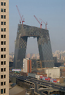 CCTV tower under construction in February 2007, Beijing, China. Architect Rem Koolhaas and OMA (Office for Metropolitan Architecture)