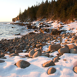 A winter sunrise in Monument Cove in Maine's Acadia National Park.