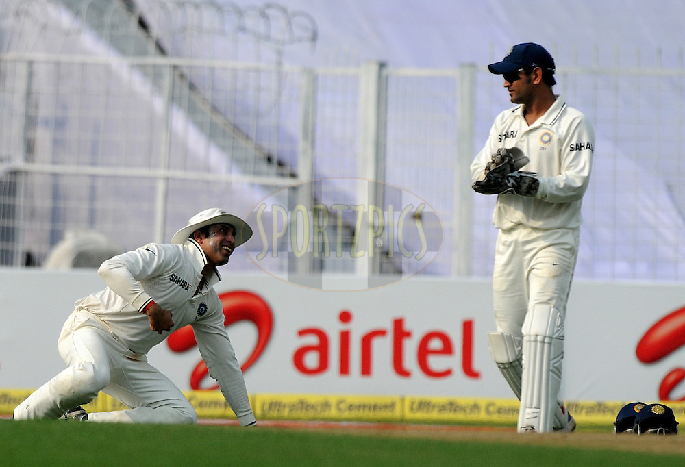 VVS Laxman of India looks on as he finishes a catch during the 3rd day of the 2nd test match between India and The West Indies held at Eden Gardens in Kolkata, India on the 16th November 2011..Photo by Pal Pillai/BCCI/SPORTZPICS