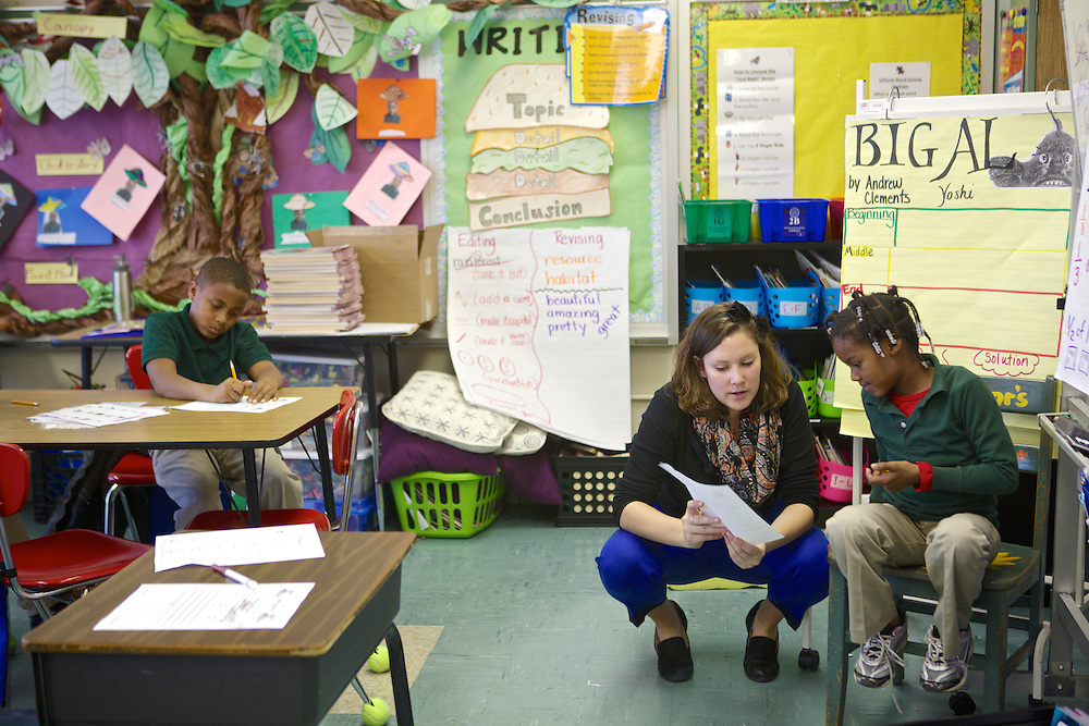 Third-grader Tyra McGhee listens as volunteer Hannah O'Brien explains a writing exercise at Adelaide Davis Elementary School on Nov. 26, 2012 in Washington, D.C. Last week DCPS Chancellor Kaya Henderson proposed closing 20 under-enrolled schools in the District. Davis Elementary is one of 20 schools in the DCPS system included in the school closure proposal. There are currently 178 students enrolled in Davis Elementary and the second floor of the school is only used for music classes and the library...CREDIT: Lexey Swall for The Wall Street Journal.DCSCHOOLS