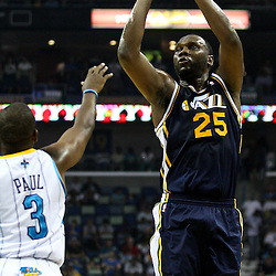 April 11, 2011; New Orleans, LA, USA; Utah Jazz center Al Jefferson (25) shoots over New Orleans Hornets point guard Chris Paul (3) during the first half at the New Orleans Arena.  Mandatory Credit: Derick E. Hingle
