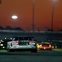 Sunset action, Rolex 24 at Daytona, Daytona International Speedway, Daytona Beach, FL, January 2014.  (Photo by Brian Cleary/www.bcpix.com)