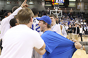 Fans are not allowed on the court following the game, but a few Mountaineers fans were able to excape, including Will Taylor (left) and Dillon Shifflett, his shirt is being tugged by an event official as he celebrates with the State Champions.  Date:  March/12/10, Madison boy's basketball team brought home the State Championship tonight defeating the Altavista Colonels 41-38.  Leading Madison were Logan Terrel, David Falk, and Jerel Carter with 10 points each.