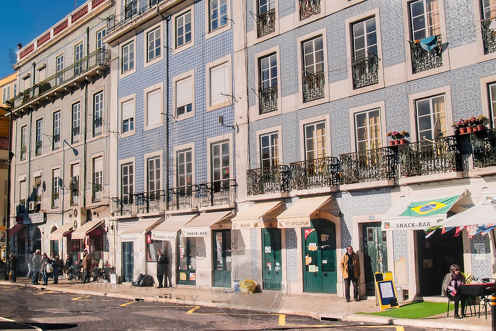 Lisbon, December 2012. Typical portuguese glazed tiled buildings in a street at Terreiro do Paço