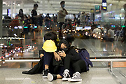 CHINA, Hong Kong: 13 August 2019 <br /> Two protesters have a moment of rest at Hong Kong International Airport on the evening of 13th August 2019. Thousands of demonstrators brought Hong Kong's airport to a standstill for a second day in a row in protest of the extradition bill as well as the police violence and brutality. Demonstrators have taken to the streets of Hong Kong in protest of a controversial extradition bill since 9th of June which has resulted in several violent clashes.<br /> Rick Findler / Story Picture Agency