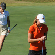 Wake Forest's Erica Herr, left, and Oklahoma State's Kenzie Neisen prepare to putt Sunday October 26, 2014 during the 13th annual Landfall Tradition in Wilmington, N.C. (Jason A. Frizzelle)
