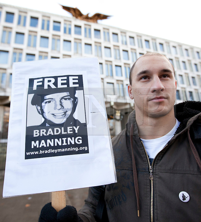 © Licensed to London News Pictures. 17/12/2011. LONDON, UK. A Bradley Manning supporter stands outside the US Embassy during a protest in London today. The protest, taking place on Manning's 24th birthday, called for his release from custody in the US where he is being held for leaking 720,000 diplomatic and military documents to website Wikileaks. Photo credit: Matt Cetti-Roberts/LNP