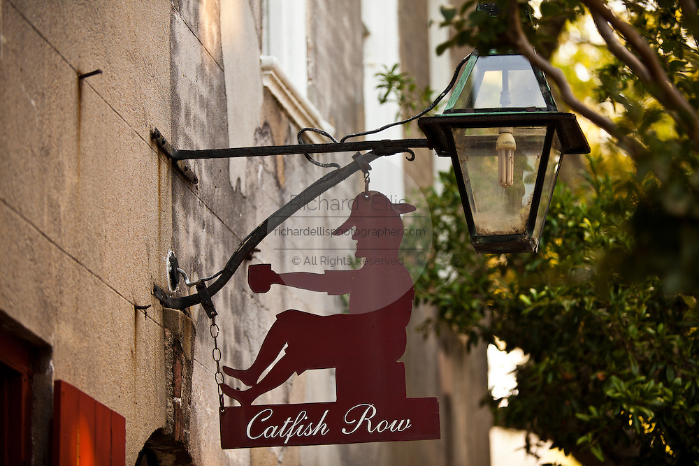 Catfish row marker on historic houses along Church Street Charleston, SC.