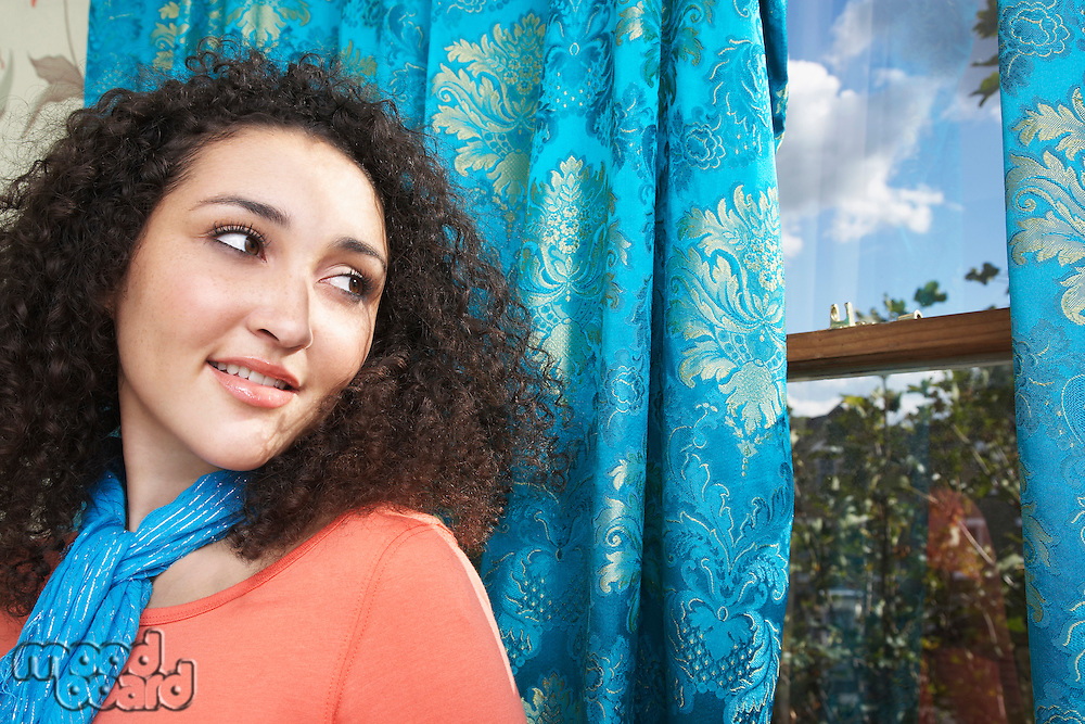 Teenage Girl in scarf  looking over shoulder out window