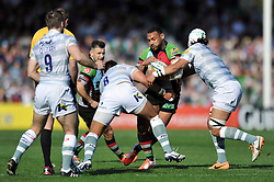 Jordan Turner-Hall (Harlequins) takes on the London Irish defence - Photo mandatory by-line: Patrick Khachfe/JMP - Tel: Mobile: 07966 386802 29/03/2014 - SPORT - RUGBY UNION - The Twickenham Stoop, London - Harlequins v London Irish - Aviva Premiership.