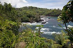 View of Onomea Bay, one of the highlights of driving the short scenic route off of Highway 19, north of Hilo.  This narrow, four-mile ramble follows a part of the old Mamalahoa Highway and is a major highlight of the Hilo-Hamakua Heritage Coast.