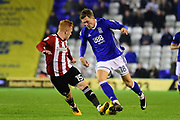 Birmingham City striker (on loan from Southampton) Sam Gallagher (18) sprints forward with the ball under pressure from  Brentford FC midfielder Ryan Woods (15) during the EFL Sky Bet Championship match between Birmingham City and Brentford at St Andrews, Birmingham, England on 1 November 2017. Photo by Dennis Goodwin.