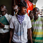Liberians wait to hear the verdict of accused war criminal and former president of Liberia Charles Taylor. Monrovia, Liberia, April 26, 2012.