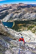 Rock climber on Tenaya Peak, Tuolumne Meadows, Yosemite National Park, California USA