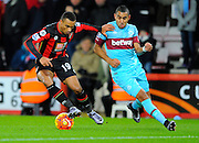 AFC Bournemouth midfielder Junior Stanislas and West Ham Utd midfielder Dimitri Payet during the Barclays Premier League match between Bournemouth and West Ham United at the Goldsands Stadium, Bournemouth, England on 12 January 2016. Photo by Graham Hunt.