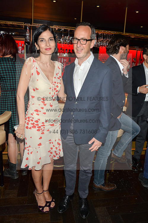 YASMIN MILLS and DAVID LOEWI MD of D&D London at the launch of Giovanni's Gin Joint at Quaglino's, 16 Bury Street, London on 13th July 2016.