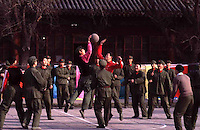 Chinese soldiers playing basketball on a break..photo by Owen Franken.