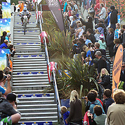 Indi Clendon from Queenstwown, in action in the Veteran Women's Class, heads down the Brecon Street steps in Queenstown during the Corona Dirtmasters Downhill event in Queenstown, Central Otago. Eighty competitors tackled the technically demanding course which started at the Gondola summit and finished with a run down the steps in Brecon Street, Queenstown. The event was part of the inaugural Queenstown Bike Festival, which took place from 16th-25th April. The event hopes to highlight Queenstown's growing profile as one of the three leading biking centres in the world. Queenstown, Central Otago, New Zealand. 24th April 2011. Photo Tim Clayton..