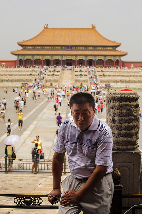 A man takes a rest inside the Forbidden City in Beijing.