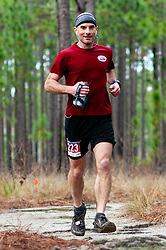 January 19, 2019 - Southern Pines, North Carolina, US - Jan. 19, 2019 - Southern Pines N.C., USA - Scott Harber, Charlotte, North Carolina, completes a lap during the 10th Annual Weymouth Woods 100km ultra marathon at the Weymouth Woods Nature Preserve. Runners needed to complete 14 laps of the 4.47 mile course for 62.58 miles in under the 20-hour time allotment. (Credit Image: © Timothy L. Hale/ZUMA Wire)