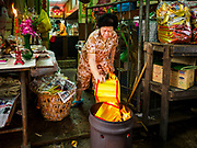 "05 SEPTEMBER 2017 - BANGKOK, THAILAND:  A woman in Bangkok's Chinatown burns ghost money on Hungry Ghost Day. The Ghost Festival is a Buddhist and Taoist holy day celebrated on the 15th day of the 7th lunar month. It is primarily celebrated in China and Chinese communities outisde China. In Thailand, it's celebrated in Thai-Chinese communities in Bangkok, Phuket and Chiang Mai.  On that day ghosts and spirits, including those of the deceased ancestors, come out from the lower realm to visit the living. Families prepare elaborate banquets for the spirits and burn ""ghost money"" for the spirits to use in the other realm. It is a day for venerating dead relatives.     PHOTO BY JACK KURTZ"