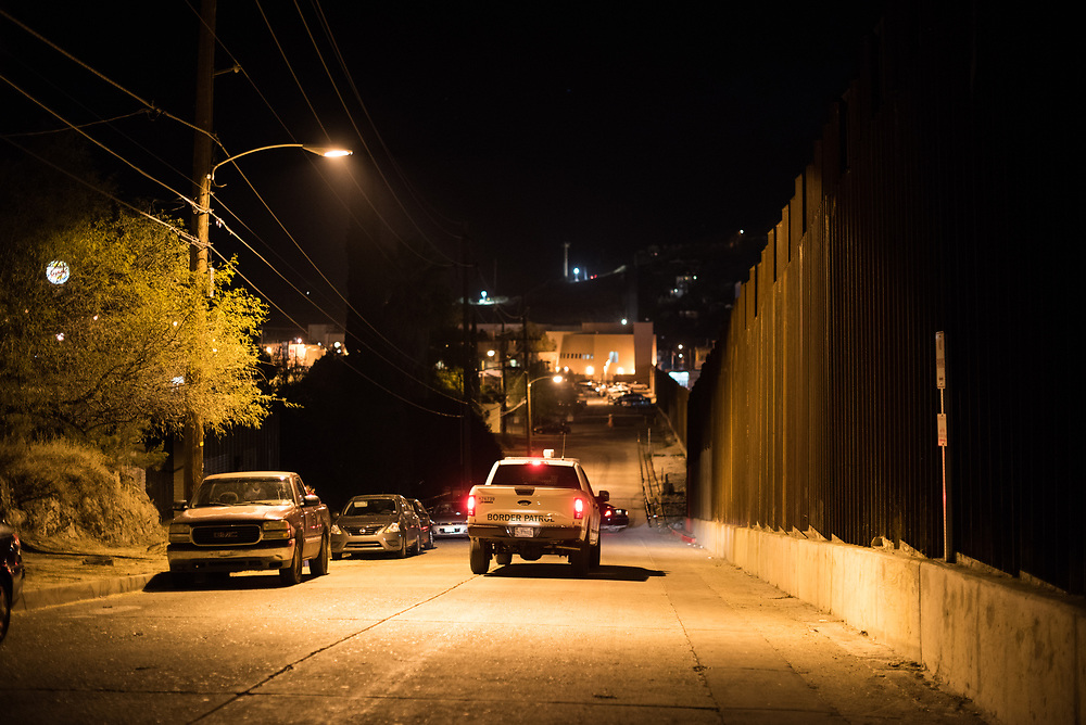 Border Patrol drives down International Street in Nogales, Arizona on November 11, 2017.