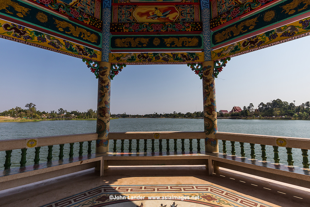 Chao Pu-Ya Chinese Spirit Shrine and Lake is adjacent to the Thai-Chinese Cultural Centre; together they form the focal point of  Chaloem Phrakiat Park.  The shrine is a large Chinese spirit shrine with a Chinese rock garden that overlooks the lake. Two Chinese pavilions stand in the lake, serving as a view point in cool, breezy and shady surroundings. The golden dragon, used during the Thung Si Mueang annual festival in December, is kept here.  Most visitors assume that Chao Pu-Ya is a part of the Thai-Chinese Cultural Cener as they are across the street from each other.