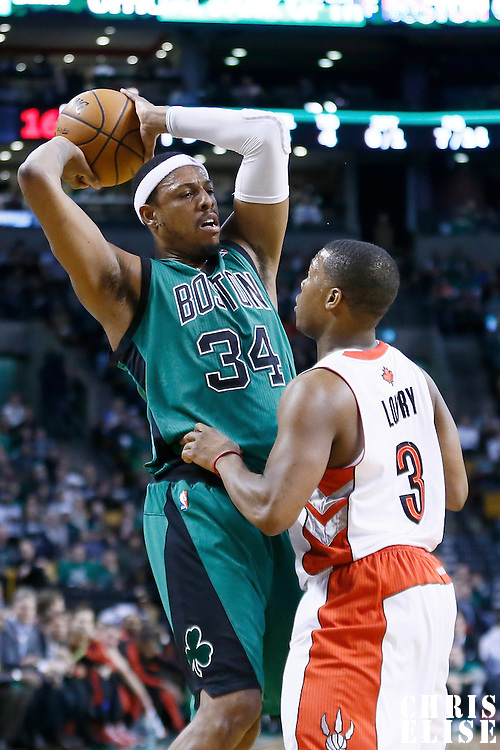 13 March 2013: Toronto Raptors point guard Kyle Lowry (3) defends on Boston Celtics small forward Paul Pierce (34) during the Boston Celtics 112-88 victory over the Toronto Raptors at the TD Garden, Boston, Massachusetts, USA.
