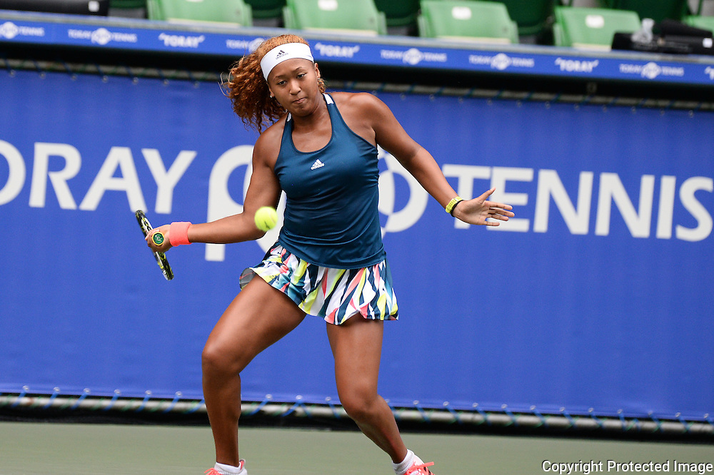 SEPTEMBER 21: Naomi Osaka of Japan competes against Dominika Cibulkova of Slovakia during women's singles match day three of the Toray Pan Pacific Open at Ariake Colosseum on September 21, 2016 in Tokyo, Japan 21/09/2016-Tokyo, JAPAN