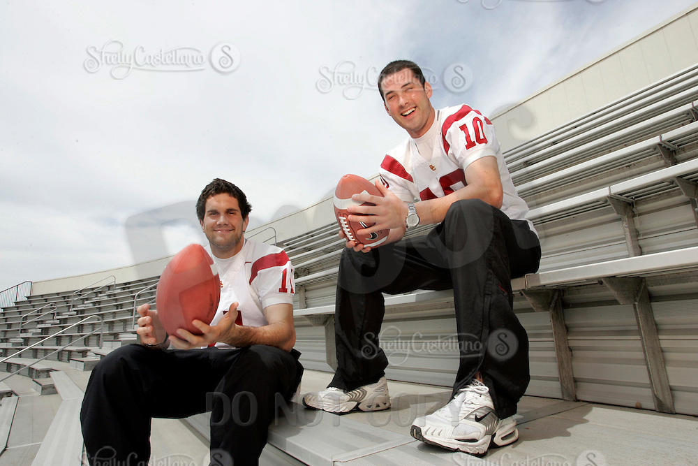 7 April 2005: USC Trojans Quarterback Outdoor Portraits of #11 Matt Leinart and #10 John David Booty. In white uniform together hanging out together.  Photo by:  Shelly Castellano.com