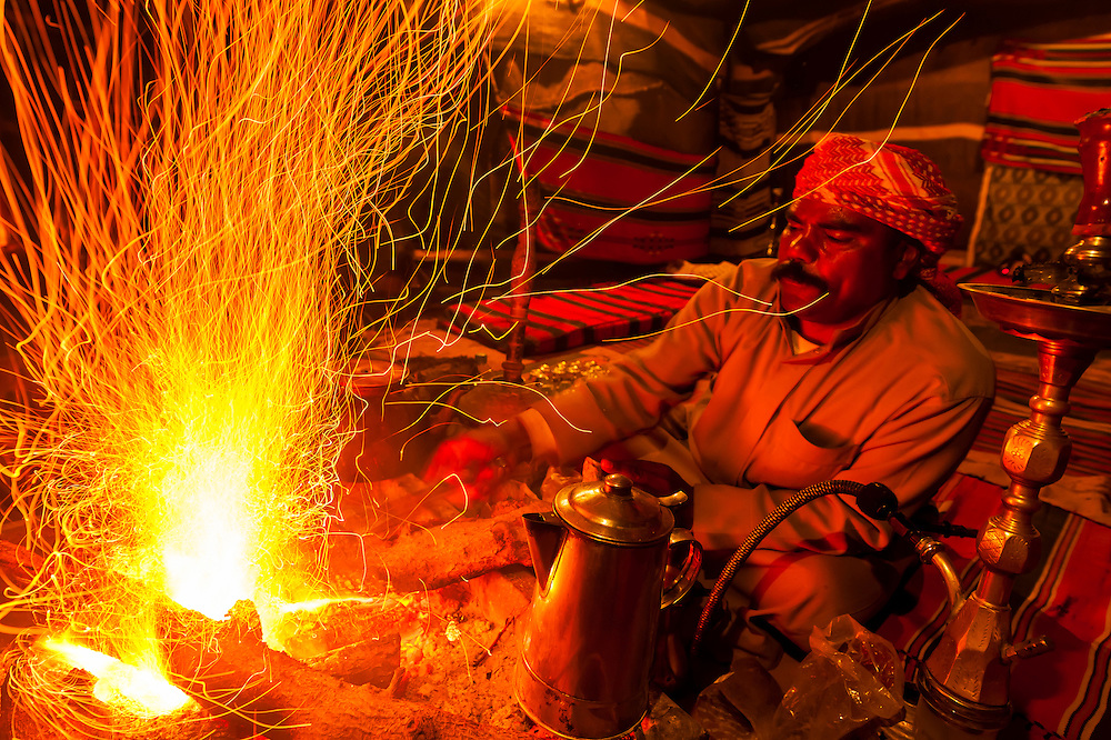 Bedouin man roasting coffee beans over a campfire at Captain's Desert Camp, Wadi Rum, Jordan