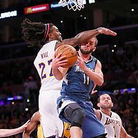 10 November 2013: Minnesota Timberwolves point guard J.J. Barea (11) goes for the layup past Los Angeles Lakers center Jordan Hill (27) during the Minnesota Timberwolves 113-90 victory over the Los Angeles Lakers at the Staples Center, Los Angeles, California, USA.