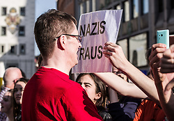 April 28, 2018 - Munich, Bavaria, Germany - A Pegida participant began arguing with the demonstrators, who then held up a sign reading ''nazis out!''. Inviting Pegida founder Lutz Bachmann Pegida Dresden returned to Munich for a repeat of last month's march through one of the most-traveled portions of the city.  Last month, just a few hours after Bachmann's appearance in Munich, he was arrested at London-Stansted airport and subsequently deported back to Germany. (Credit Image: © Sachelle Babbar via ZUMA Wire)