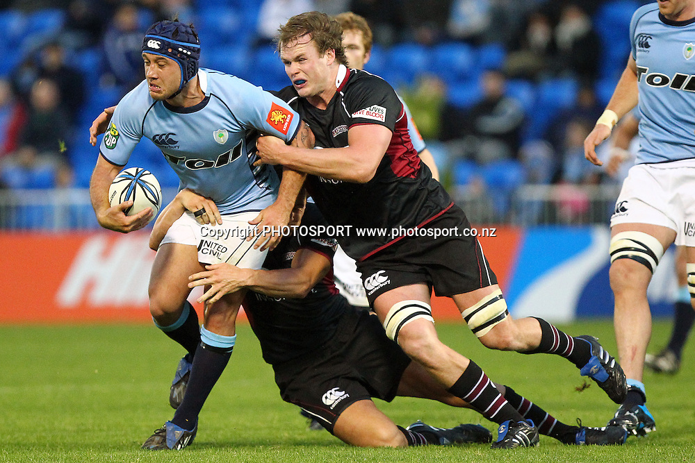 Northland's Aaron Bancroft is tackled by Harbour's Tom Chamberlain. ITM Cup rugby union match, Northland v North Harbour at Northland Events Centre Toll Stadium, Whangarei, New Zealand. Sunday 8th August 2010. Photo: Anthony Au-Yeung/PHOTOSPORT