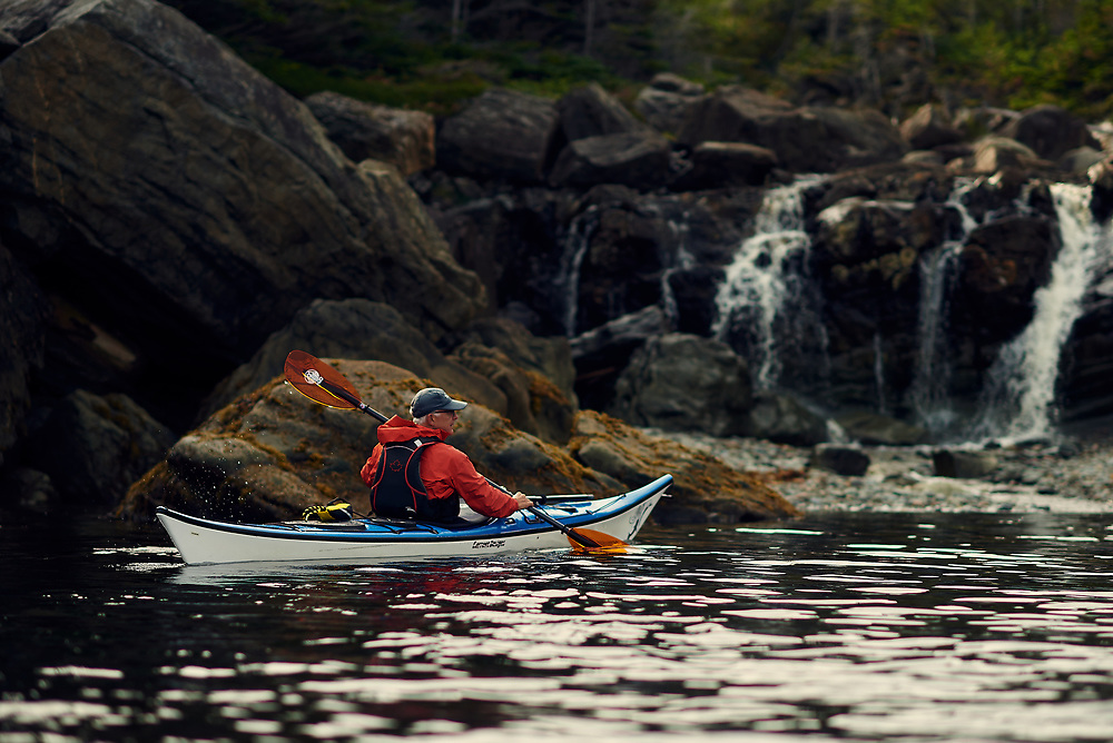 Sea kayaking tour of Boone Bay with a guide from Gros Morne Morne Adventures in Boone Bay Harbor Newfoundland, Canada