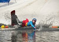 """Emma Fortin's """"super powers"""" came up a wee bit short during her pond crossing attempt at Gunstock's annual end of the season B.Y.O.D.C. event on Sunday afternoon.  (Karen Bobotas/for the Laconia Daily Sun)"""
