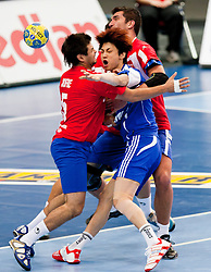 15.01.2011, Göteborg, SWE, IHF Handball Weltmeisterschaft 2011, Herren, Chile vs Korea im Bild, //  Chile defense stop Korea player // during the IHF 2011 World Men's Handball Championship match Chile vs Korea at Göteborg. EXPA Pictures © 2010, PhotoCredit: EXPA/ Skycam/ Per Friske +++ATTENTION+++ out of Sweden (SWE)