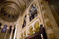 25 November, 2008. New York, NY. The south pipes are shown here at the cathedral of St/ John the Divine. At the bottom center is joseph Niesen, 36, who tunes the organ with his colleagues. The organ at the Cathedral of St. John the Divine, heavily damaged in a fire in 2001, has been rebuilt. The organ has been tuned for the last couple of weeks.  ©2008 Gianni Cipriano for The New York Times<br /> cell. +1 646 465 2168 (USA)<br /> cell. +1 328 567 7923 (Italy)<br /> gianni@giannicipriano.com<br /> www.giannicipriano.com