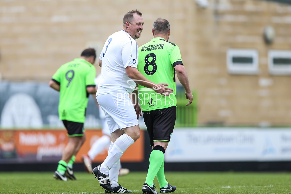 Trevor Horsley XI Mike Bulbeck and Forest Green Legends Marc McGregor during the Trevor Horsley Memorial Match held at the New Lawn, Forest Green, United Kingdom on 19 May 2019.