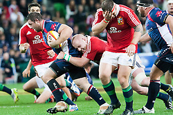 © Licensed to London News Pictures. 25/6/2013. Ged Robinson gets tackled during the British & irish Lions tour match between Melbourne Rebels Vs British & Irish Lions at AAMI Park, Melbourne, Australia. Photo credit : Asanka Brendon Ratnayake/LNP