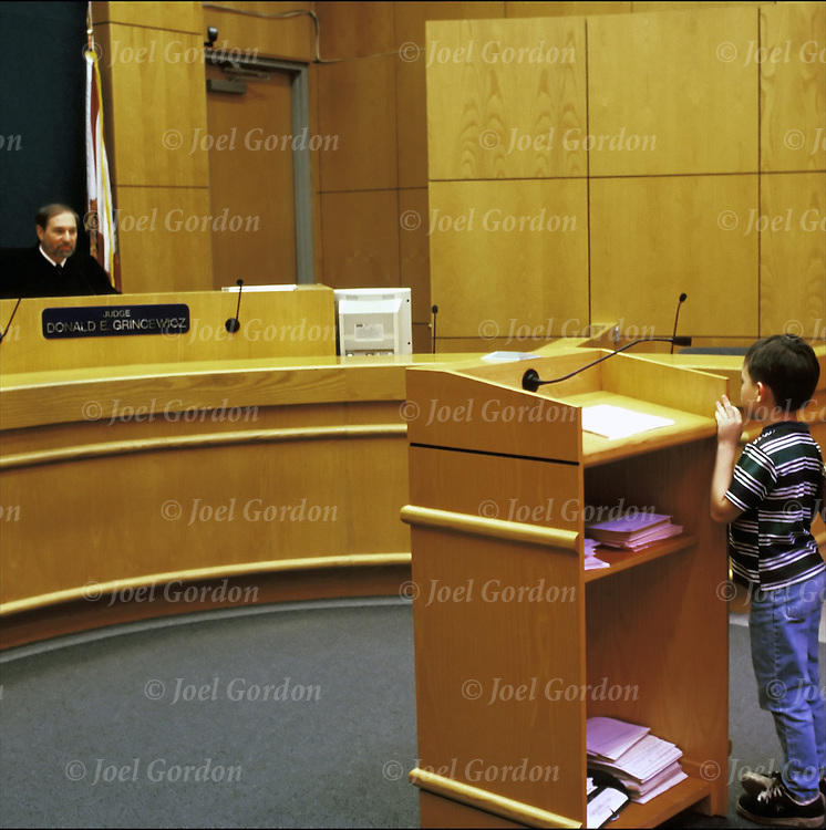Preliminary hearing - young Caucasian juvenile boyand his mother before the judge - Juvenile Court - Ninth Judical Circuit Court State of Florida,  Orlando, FL