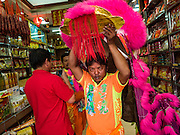 "08 FEBRUARY 2016 - BANGKOK, THAILAND:  Lion dancers perform inside a small Chinese grocery shop for Chinese New Year on Yaowarat Road in Bangkok's Chinatown district, during the celebration of the Lunar New Year. Chinese New Year is also called Lunar New Year or Tet (in Vietnamese communities). This year is the ""Year of the Monkey."" Thailand has the largest overseas Chinese population in the world; about 14 percent of Thais are of Chinese ancestry and some Chinese holidays, especially Chinese New Year, are widely celebrated in Thailand.      PHOTO BY JACK KURTZ"