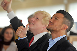© licensed to London News Pictures. LONDON, UK.  14/06/11.Boris Johnson and Peter Andre read the children's book 'The Gruffalo' to a group of schoolchildren as they  launch a new literacy scheme at Botwell Green Library in Hayes, Middlesex, today 14 June 2011. The scheme will help encourage parents to read to their children. Photo credit should read Stephen Simpson/LNP